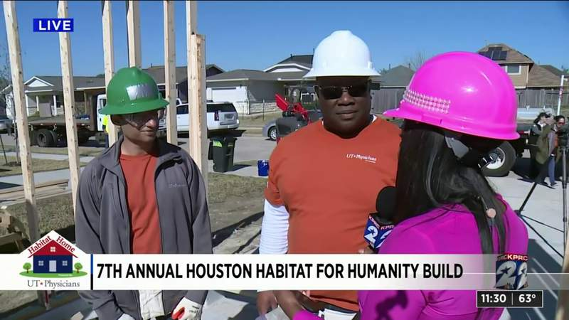 Volunteers with UT Physicians working on day 2 of Habitat for Humanity build