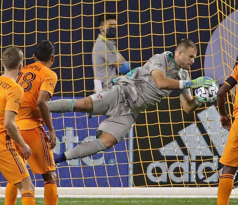 Marko Maric #1 of Houston Dynamo makes a save against the Chicago Fire FC at Soldier Field on September 23, 2020 in Chicago, Illinois. The Fire FC defeated the Dynamo 4-0. (Photo by Jonathan Daniel/Getty Images)