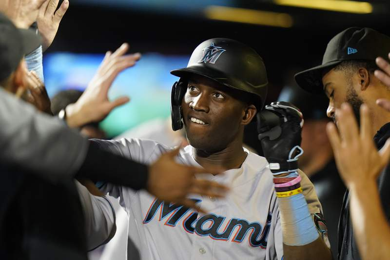 Miami Marlins' Jesus Sanchez celebrates with teammates after hitting a home run during the second inning in the second baseball game of a doubleheader against the New York Mets Tuesday, Sept. 28, 2021, in New York. (AP Photo/Frank Franklin II)