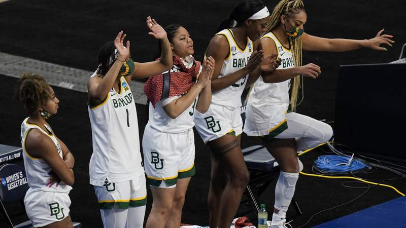 Baylor players celebrate on the bench during the second half of a college basketball game against Jackson State in the first round of the women's NCAA tournament at the Alamodome, Sunday, March 21, 2021, in San Antonio. Baylor won 101-52.