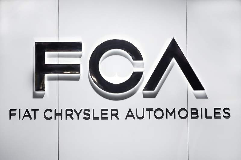 """FILE - In this Monday, Jan. 14, 2019 file photo, Fiat Chrysler Automobiles FCA logo is shown at the North American International Auto Show in Detroit. Fiat Chrysler Automobiles is denying allegations by General Motors that FCA used foreign bank accounts to bribe union officials so they would stick GM with higher labor costs. In court papers filed Monday,  Aug. 10, 2020 the Italian-American automaker said GM was using court records to make defamatory and baseless"""" claims.   (AP Photo/Paul Sancya, file)"""