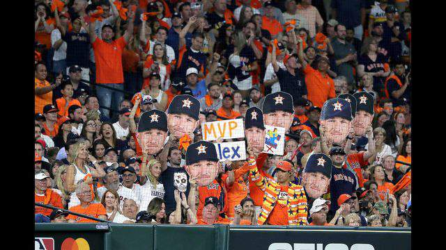 HOUSTON, TEXAS - OCTOBER 19:  Fans hold signs for Alex Bregman (not pictured) in game six of the American League Championship Series between the Houston Astros and the New York Yankees at Minute Maid Park on October 19, 2019 in Houston, Texas. (Photo by Elsa/Getty Images)