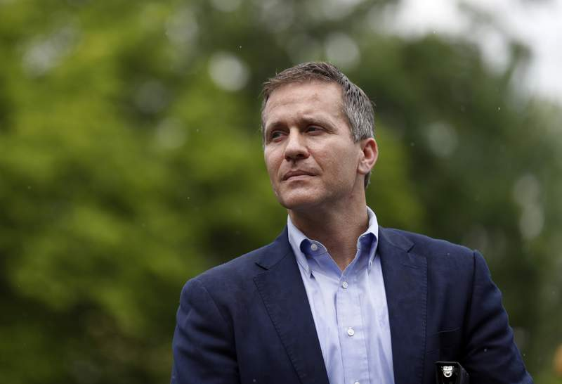 FILE- In this May 17, 2018, photo, then Missouri Gov. Eric Greitens waits to deliver remarks to a small group of supporters near the capitol in Jefferson City, Mo. Greitens' political future seemed doomed by scandal when he resigned as Missouri governor. Now, he appears primed to test whether Sen. Roy Blunt's retirement provides a path for redemption within a Republican Party searching for direction after former President Donald Trump's election loss. (AP Photo/Jeff Roberson, File)
