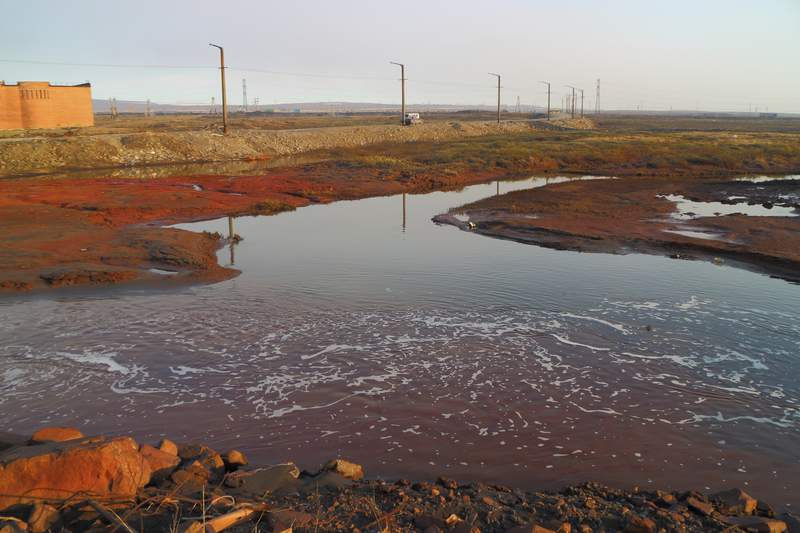 This handout photo provided by Vasiliy Ryabinin shows oil spill outside Norilsk, 2,900 kilometers (1,800 miles) northeast of Moscow, Russia, Friday, May 29, 2020. Russian authorities have charged Vyacheslav Starostin, the director of an Arctic power plant that leaked 20,000 tons of diesel fuel into the ecologically fragile region on May 29, 2020, with violating environmental regulations.  An investigation is ongoing Monday JUne 8, 2020, into the alleged crime, that could bring five years in prison if Starostin is found guilty. (Vasiliy Ryabinin via AP)
