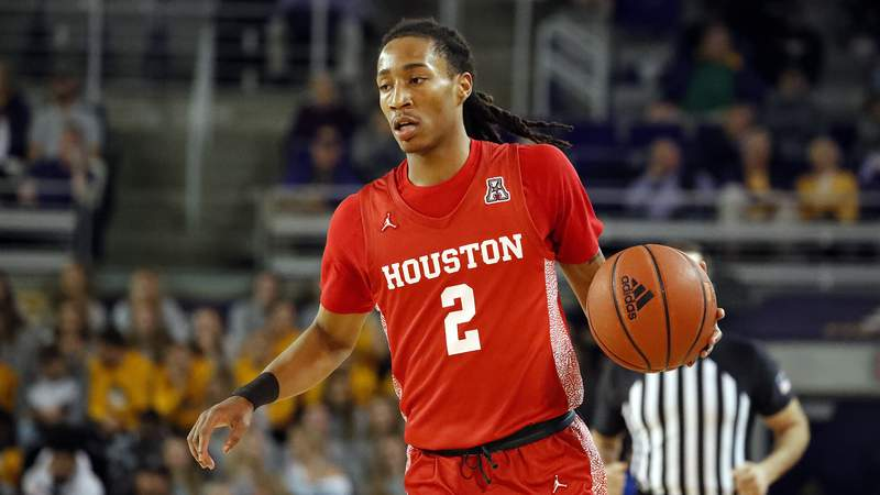 Houston's Caleb Mills (2) drives the ball against East Carolina during the first half of an NCAA college basketball game in Greenville, N.C., Wednesday, Jan. 29, 2020. (AP Photo/Karl B DeBlaker)