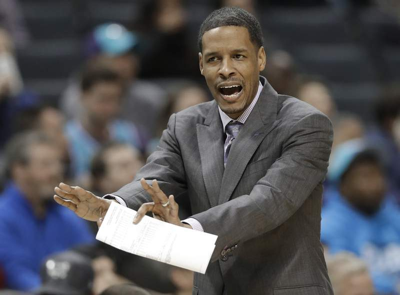FILE - In this Dec. 15, 2017, file photo, Charlotte Hornets associate head coach Stephen Silas argues a call during the first half of the team's NBA basketball game against the Miami Heat in Charlotte, N.C. The Houston Rockets and Silas have an agreement for the Dallas assistant to replace Mike D'Antoni as coach, multiple people with knowledge of the deal said Wednesday, Oct. 28, 2020. (AP Photo/Chuck Burton, File)