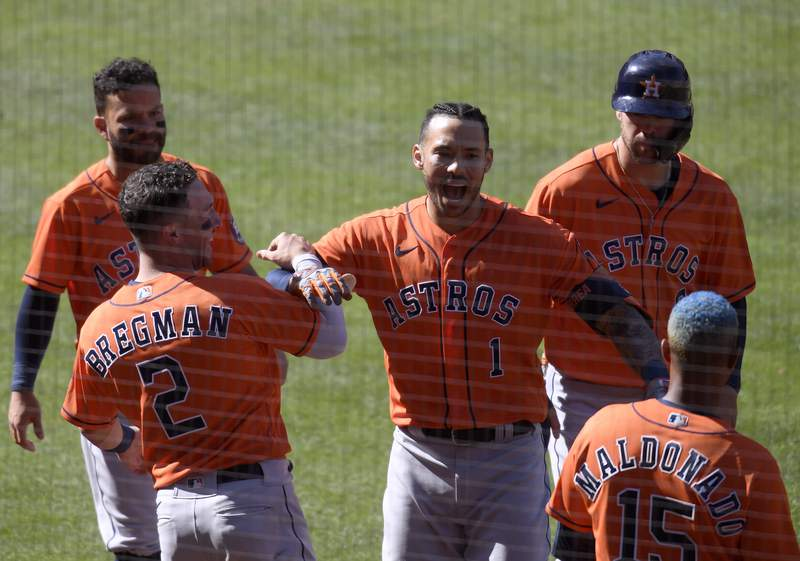 ANAHEIM, CALIFORNIA - APRIL 06: Carlos Correa #1 of the Houston Astros, celebrates his two run homerun with Alex Bregman #2, to take a 4-2 lead over the Los Angeles Angels, during the 10th inning at Angel Stadium of Anaheim on April 06, 2021 in Anaheim, California. (Photo by Harry How/Getty Images)