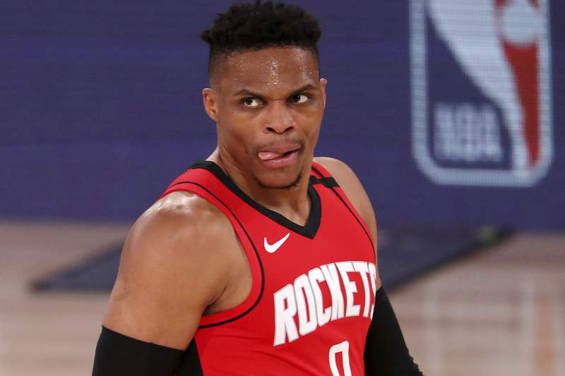 Houston Rockets' Russell Westbrook looks on during the second half of an NBA basketball game against the Dallas Mavericks, Friday, July 31, 2020, in Lake Buena Vista, Fla. (Mike Ehrmann/Pool Photo via AP)