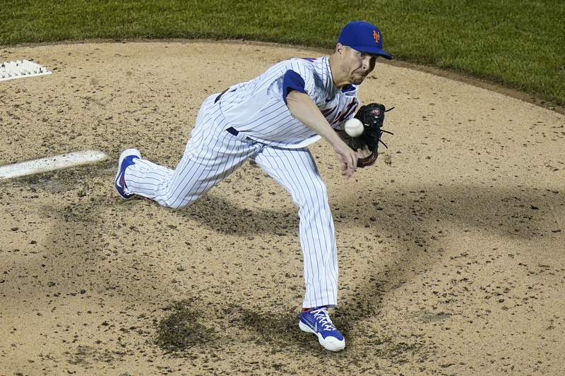 New York Mets' Jacob deGrom delivers a pitch during the fourth inning of a baseball game against the Boston Red Sox Wednesday, April 28, 2021, in New York. (AP Photo/Frank Franklin II)