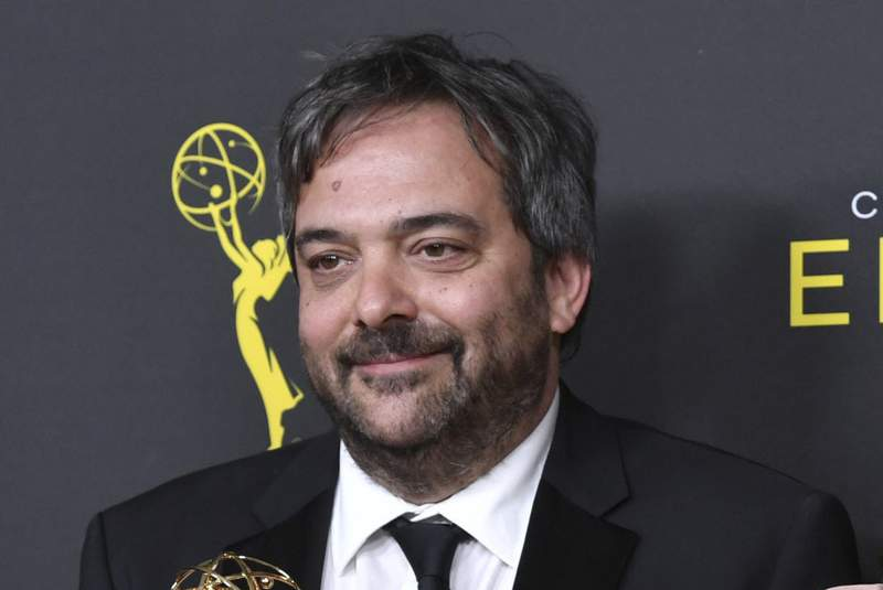 """FILE - Adam Schlesinger, winner of the awards for outstanding original music and lyrics for """"Crazy Ex Girlfriend,"""" in the press room at the Creative Arts Emmy Awards in Los Angeles on Sept. 14, 2019. An eclectic lineup of musicians is turning out for an online tribute to Adam Schlesinger, the prolific songwriter who died a year ago of COVID-19. Members of the Monkees, R.E.M., Dashboard Confessional and the Black Keys are expected, along with Sean Ono Lennon, Courtney Love, Drew Carey and Rachel Bloom. The musical celebration will premiere May 5 on the Rolling Live platform. (Photo by Richard Shotwell/Invision/AP, File)"""