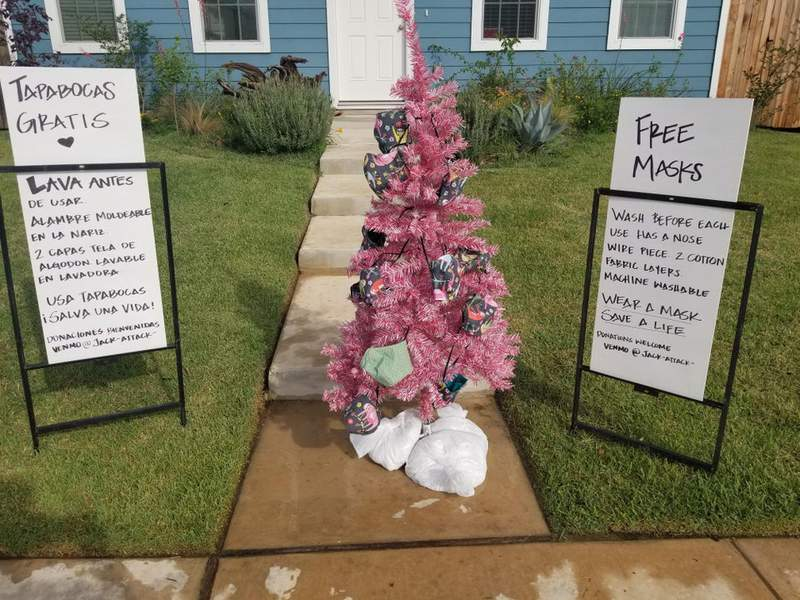 The image posted by Kyle resident Jacqueline Smith decorated her pink Christmas tree with free face masks.