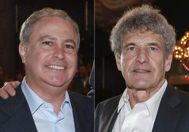 """In this combination photo, Alan Bergman, left, and Alan F. Horn, attend the premiere of """"The Mandalorian"""" in Los Angeles on Nov. 13, 2019. The Walt Disney Company announced Monday, Dec. 21, 2020 that  Bergman has been named Chairman, Disney Studios Content, effective January 1, and Horn will continue to serve as the divisions Chief Creative Officer. (Photo by Mark Von Holden/Invision/AP, file)"""