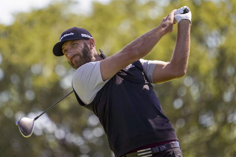 FILE - In this Saturday, Sept. 19, 2020, file photo, Dustin Johnson hits from the fourth tee during the third round of the U.S. Open Golf Championship, in Mamaroneck, N.Y. Dustin Johnson withdrew from the CJ Cup at Shadow Creek on Tuesday, Oct. 13, 2020, because of the coronavirus, the most prominent player since golf resumed in June to test positive. The PGA Tour said in a statement that Johnson notified officials he was experiencing COVID-19 symptoms and was given another test that came back positive. (AP Photo/John Minchillo, File)
