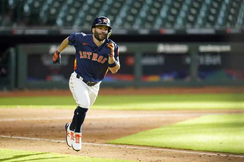 Houston Astros' Jose Altuve runs toward first base during an intrasquad baseball game Monday, July 13, 2020, in Houston. (AP Photo/David J. Phillip)