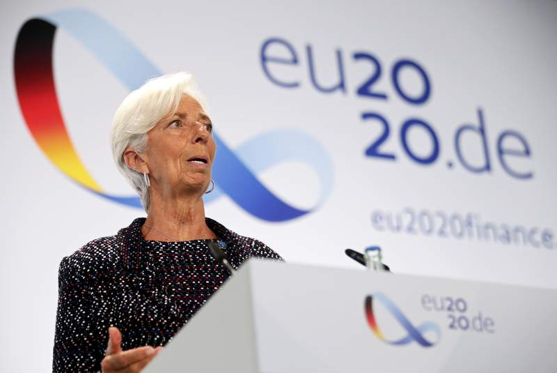 FILE - In this Sept. 11, 2020 file photo, European Central Bank (ECB) President Christine Lagarde attends a news conference during the Informal Meeting of Economics and Finance Ministers in Berlin, Germany.   The European Central Bank held off from strengthening its stimulus programs despite growing concern that a renewed surge in COVID-19 cases could stall the economys recovery from the deep downturn early this year.  The bank on Thursday, Oct. 29,  made no change to its 1.35 trillion ($1.58 trillion) pandemic emergency bond purchase program, which pumps newly created money into the economy to keep credit flowing to businesses and promote economic activity.   Hannibal Hanschke/Pool Photo via AP, File)