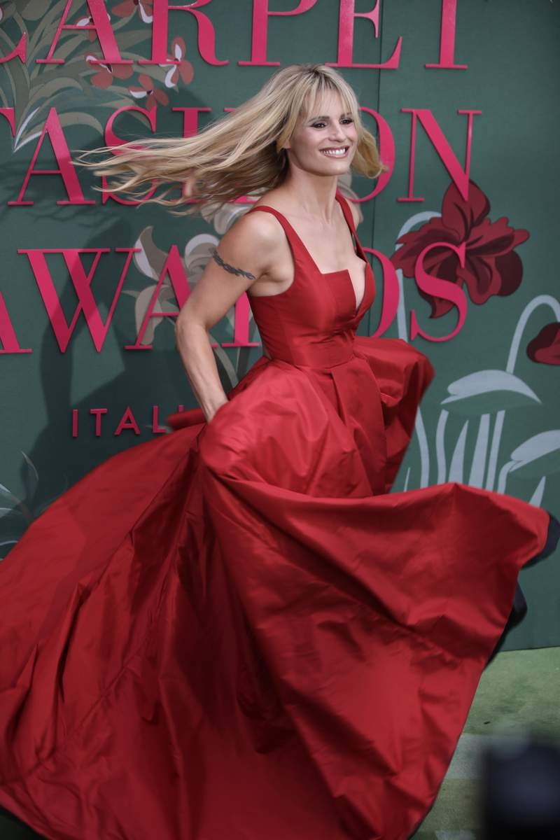 Michelle Hunziker upon her arrival at the Green Carpet Fashion Awards in Milan, Italy, on Sept. 22, 2019. Swiss-Italian TV host Michelle Hunziker apologized on Wednesday, April 14, 2021, for mimicking Asians on a satirical television program that drew wide-spread protests on social media. (AP Photo/Luca Bruno)