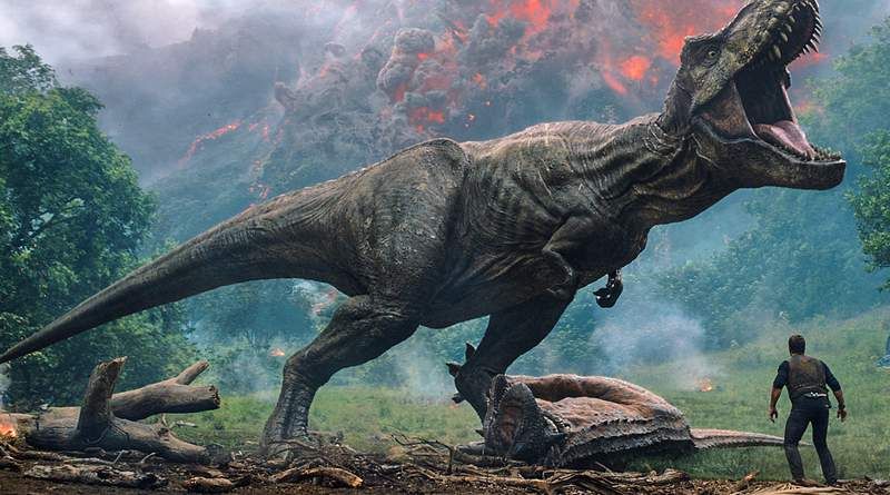 """This image released by Universal Pictures shows a scene from the upcoming """"Jurassic World: Fallen Kingdom."""" Filming on the new Jurassic World: Dominion movie has been suspended for two weeks in the U.K. because of COVID-19 cases on set. Director Colin Trevorrow tweeted Wednesday that there were a few positive tests for the virus.  (Universal Pictures via AP)"""