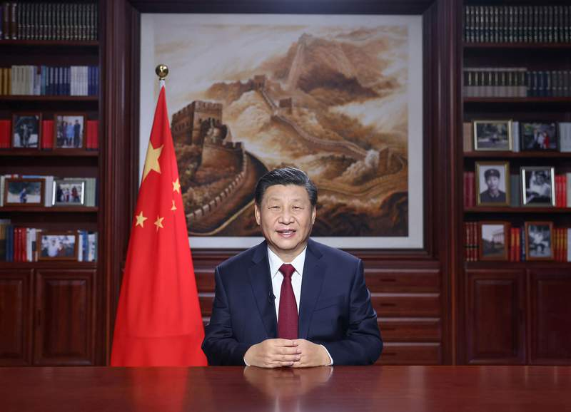 In this photo released by China's Xinhua News Agency, Chinese President Xi Jinping delivers a New Year's address in Beijing, Thursday, Dec. 31, 2020. China has made major progress in developing its economy and eradicating rural poverty over the past year despite the coronavirus pandemic, Xi said.(Ju Peng/Xinhua via AP)