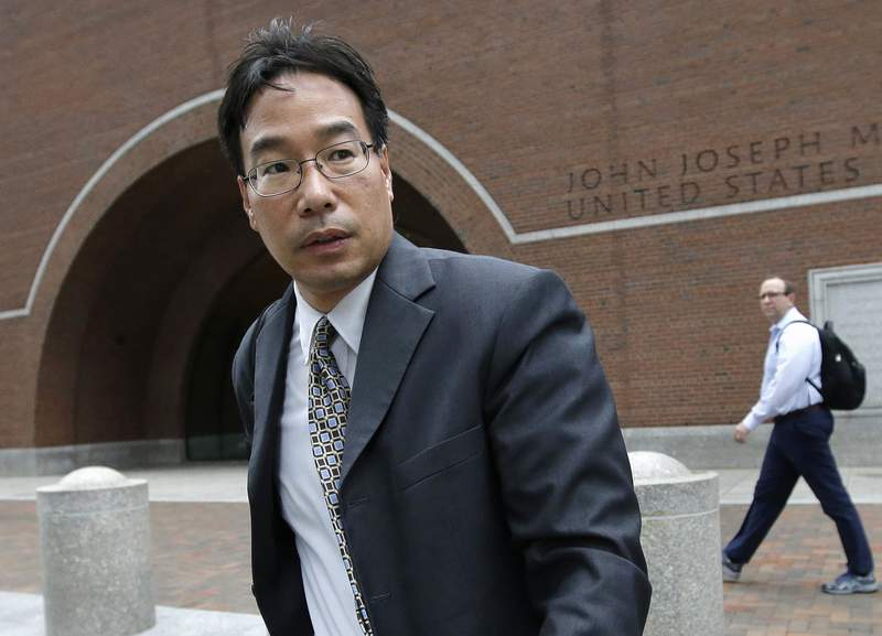 FILE - In this Sept. 19, 2017, file photo, Glenn Chin, a supervisory pharmacist at the now-closed New England Compounding Center, leaves federal court after attending the first day of his trial in Boston. Chin, convicted for his role in a deadly 2012 multistate meningitis outbreak, will spend more time behind bars after a federal judge, Wednesday, July 21, 2021, lengthened his original sentence by 2 1/2 years. (AP Photo/Steven Senne, File)