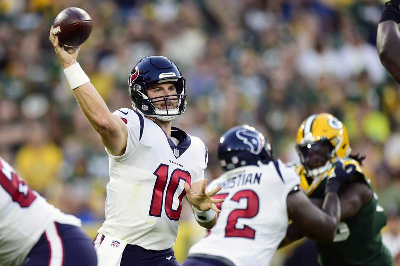 GREEN BAY, WISCONSIN - AUGUST 14: Davis Mills #10 of the Houston Texans throw a pass against the Green Bay Packers in the first half during the preseason game at Lambeau Field on August 14, 2021 in Green Bay, Wisconsin. (Photo by Patrick McDermott/Getty Images)