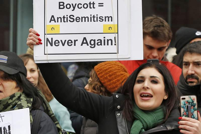 FILE - In this Jan. 19, 2019, file photo, political activist Laura Loomer holds uo a sign across the street from a rally organized by Women's March NYC after she barged onto the stage interrupting Women's March NYC director Agunda Okeyo who was speaking during a rally in New York. Loomer was escorted off the stage after the incident. A federal appeals court on Wednesday, May 27, 2020, upheld the dismissal of a lawsuit that accused Twitter, Facebook and other tech giants of conspiring to stifle the political views of a far-right activist and a conservative nonprofit.   A three-judge panel from the U.S. Court of Appeals for the District of Columbia Circuit ruled that Loomer and Freedom Watch Inc. dont have any viable claims that the companies violated their First Amendment free speech rights. (AP Photo/Kathy Willens, File)