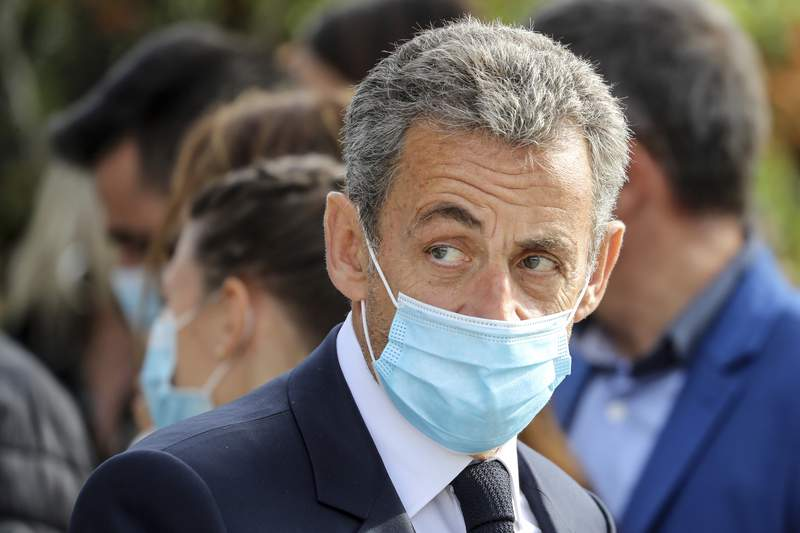 FILE - In this Oct.29, 2020 file photo, former French President Nicolas Sarkozy attends a ceremony in Nice, southern France. Former French President Nicolas Sarkozy wants authorities to drop an investigation into alleged illegal financing of his 2007 campaign by the regime of late Libyan leader Moammar Gadhafi. A French-Lebanese businessman this week backtracked on claims he made in 2016 that he had handed Sarkozy suitcases of Libyan cash (Valery Hache; Pool via AP, File)