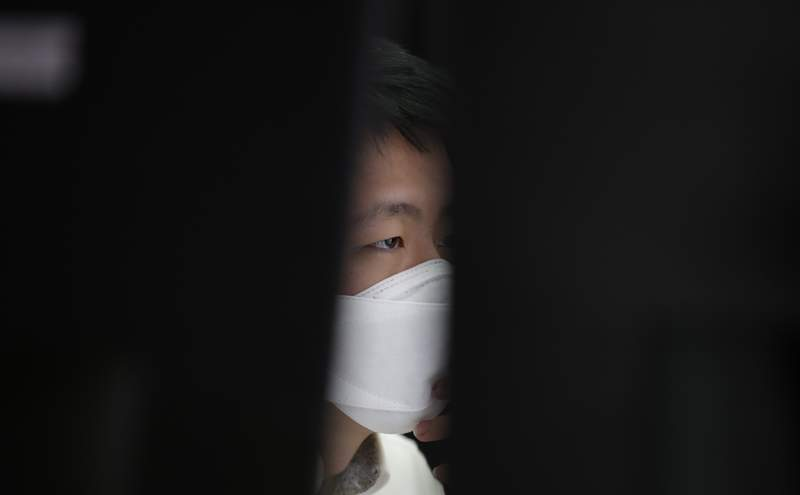 An employee of a bank wearing a face mask watches the computer monitors at the foreign exchange dealing room in Seoul, South Korea, Thursday, April 9, 2020. Asian shares are mixed, with Tokyo lower, as an overnight rally on Wall Street faded.(AP Photo/Lee Jin-man)