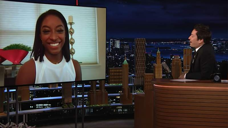 Simone Biles (left) smiles during an interview with Jimmy Fallon during The Tonight Show on April 23, 2021.