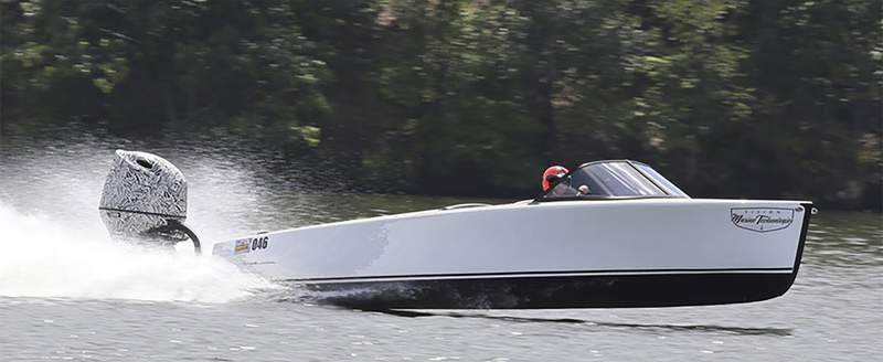 This photo provided by Jeff Helmkamp/LakeExpo shows Vision Marine Technologies' Vision Marine Bruce 22 boat with one of their E-Motion motors. The electric boat is capable of reaching speeds of 49 mph. (Jeff Helmkamp/LakeExpo via AP)