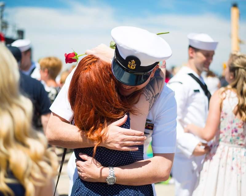 A Navy military member returns home.