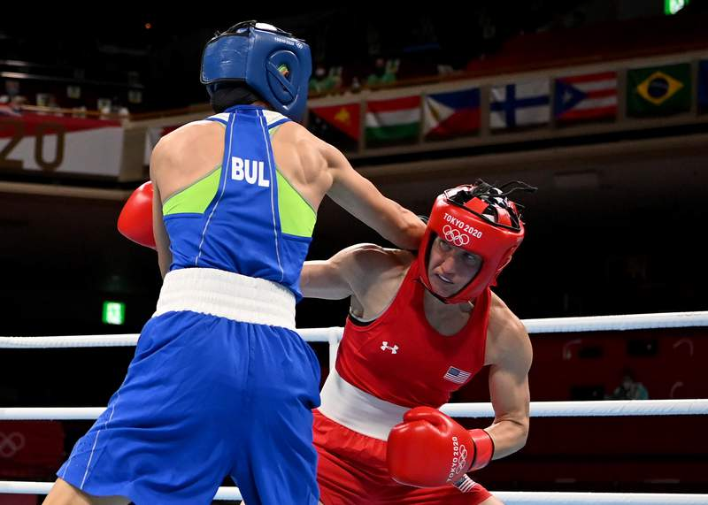TOKYO, JAPAN - JULY 29: Virginia Fuchs (red) of the United States exchanges punches with Stoyka Zhelyazkova Krasteva of Bulgaria during the Women's Fly (48-51kg) on day six of the Tokyo 2020 Olympic Games at Kokugikan Arena on July 29, 2021 in Tokyo, Japan. (Photo by Luis Robayo - Pool/Getty Images)