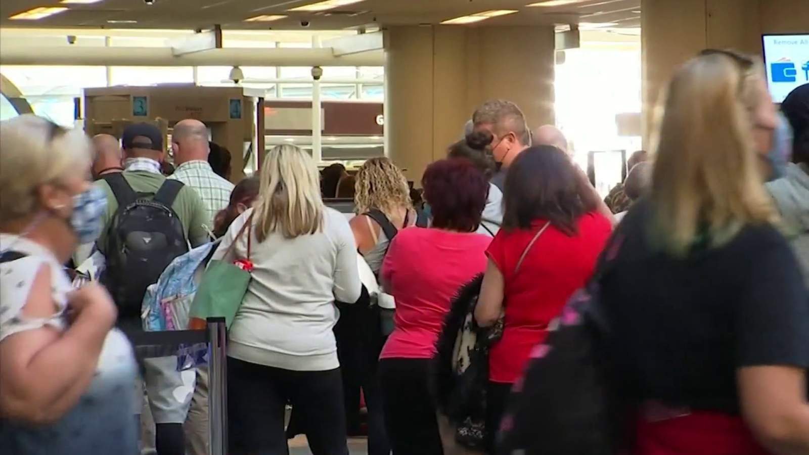 Orlando airport bustling as families travel during spring break