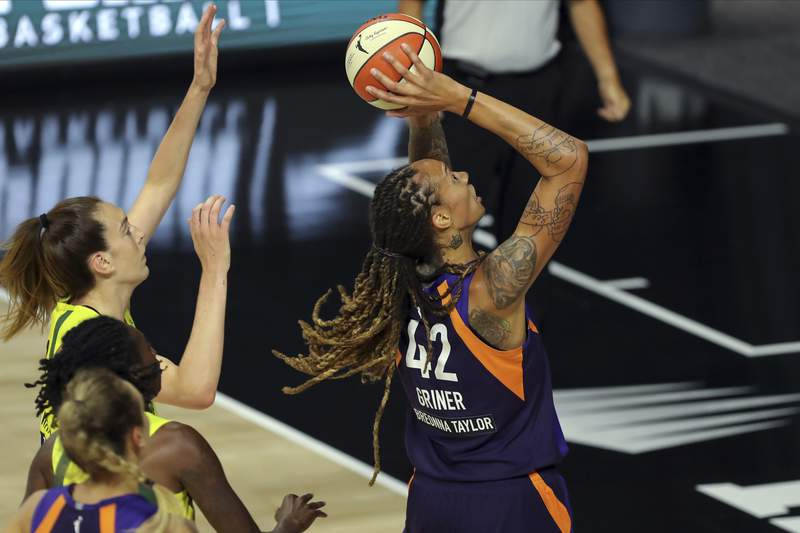 Phoenix Mercury's Brittney Griner, right, shoots against the defense of Seattle Storm's Breanna Stewart, center, during the first half of a WNBA basketball game Saturday, Aug. 8, 2020, in Bradenton, Fla. (AP Photo/Mike Carlson)
