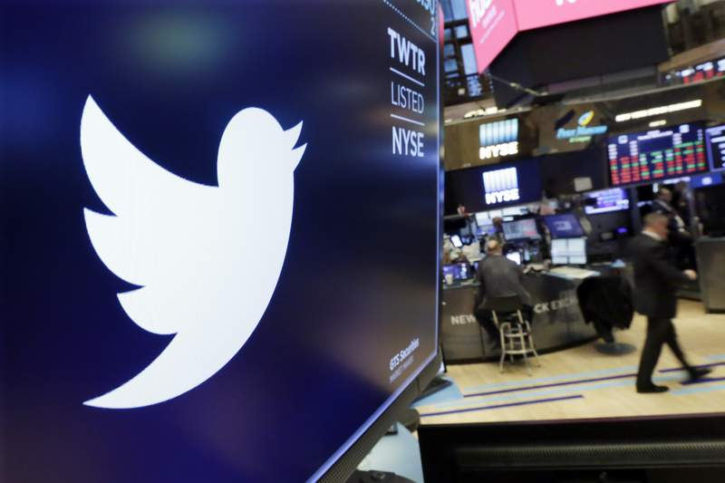 FILE - In this Feb. 8, 2018 file photo, the logo for Twitter is displayed above a trading post on the floor of the New York Stock Exchange.  Twitter says, Tuesday, June 23, 2020,  it will give its U.S. employees Election Day off going forward and employees around the world a paid day off to vote in national elections. In addition, if employees don't have enough time to vote outside of working hours in their country, the company says it will compensate them for the time it takes to do so. (AP Photo/Richard Drew, File)