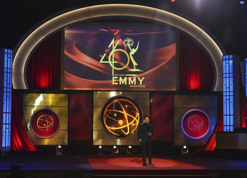 FILE - This May 5, 2019 file photo shows host Mario Lopez on stage at the 46th annual Daytime Emmy Awards in Pasadena, Calif. The Daytime Emmy Awards are skipping a theater ceremony because of the coronavirus but the honors will be presented on a TV broadcast on June 26. Nominations for the 47th annual Daytime Emmys will be announced Thursday on CBS The Talk, with categories including best drama series, talk show and game show. The TV academy that organizes the daytime awards had announced it wouldnt hold the traditional theater ceremony out of pandemic safety concerns. (Photo by Chris Pizzello/Invision/AP, File)