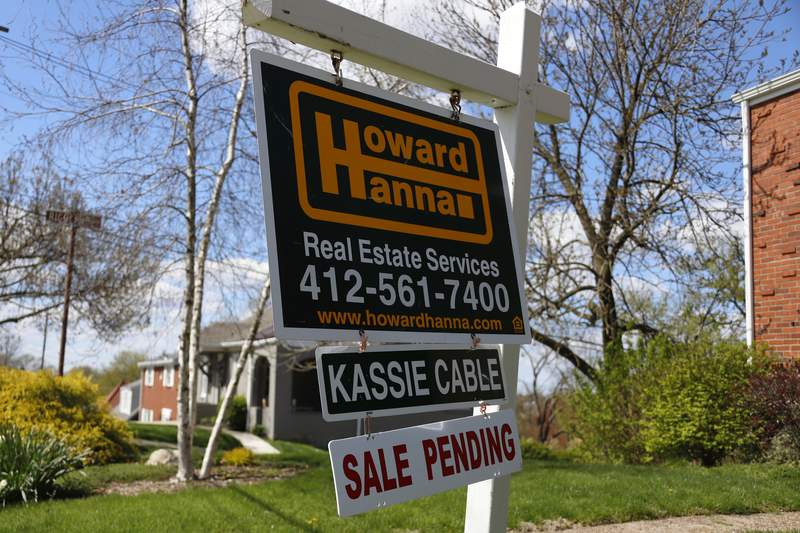 FILE - In this April 27, 2020 file photo shows a sale pending sign on a home in Mount Lebanon, Pa   The National Association of Realtors releases its April report on pending home sales, which are seen as a barometer of future purchases on Thursday, May 28.(AP Photo/Gene J. Puskar, File)