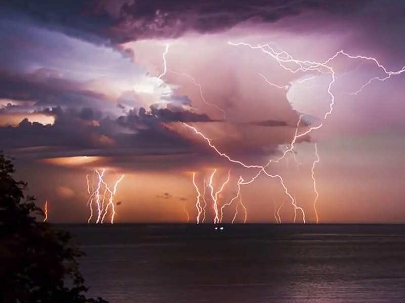 """Lake Maracaibo: The world's top lightning hotspot is over Lake Maracaibo in northwestern Venezuela. Here, nocturnal thunderstorms occur on average about 297 days per year and produce an average of about 232 lightning flashes / square kilometer / year. Local people have called this phenomenon """"Relámpago del Catatumbo"""" (Catatumbo lightning) for hundreds of years. Image by NASA."""