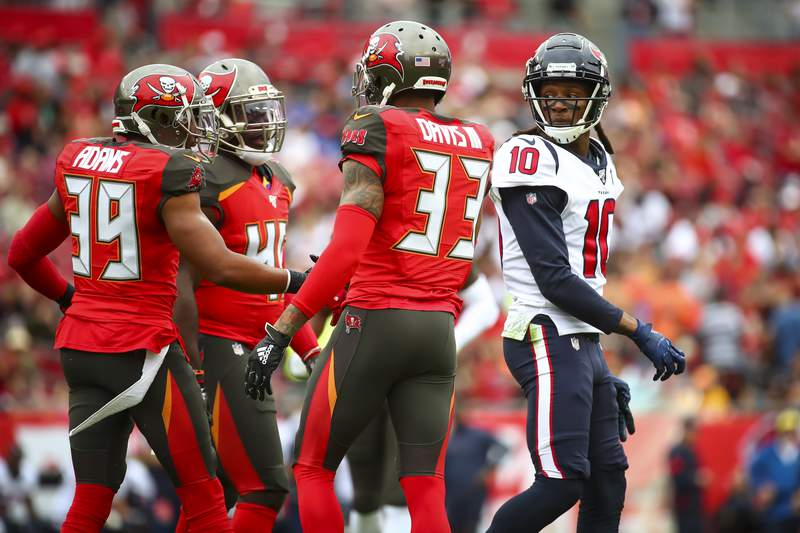 FILE PHOTO: TAMPA, FL - DECEMBER 21: DeAndre Hopkins #10 of the Houston Texans looks on as Tampa Bay Buccaneers celebrate a play during the first half on December 21, 2019 at Raymond James Stadium in Tampa, Florida. (Photo by Will Vragovic/Getty Images)