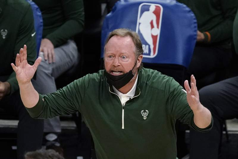 FILE - In this Feb. 18, 2021, file photo, Milwaukee Bucks coach Mike Budenholzer reacts to a call during the second half of the team's NBA basketball game against the Toronto Raptors in Milwaukee. Budenholzer has received a contract extension after guiding the team to its first NBA title in a half century. The Bucks announced Tuesday night, Aug. 24, they had signed Budenholzer to an extension. Details werent disclosed. (AP Photo/Morry Gash, File)