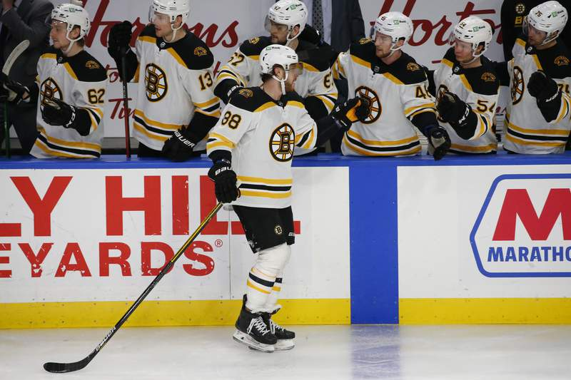 Boston Bruins forward David Pastrnak (88) celebrates his goal during the third period of an NHL hockey game against the Buffalo Sabres, Thursday, March 18, 2021, in Buffalo, N.Y. (AP Photo/Jeffrey T. Barnes)