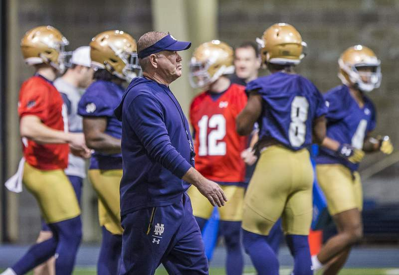 FILE - In this March 2, 2019, file photo, Notre Dame coach Brian Kelly walks on the field during the NCAA college football team's spring practice in South Bend, Ind. The NCAA's football oversight committee expects to finalize a plan on Thursday to allow teams to conduct up to 12 unpadded, slow-speed practices, also know as walk-throughs, during the 14 days before the typical preseason begins in August. Kelly said the extra time on the field with a ball will be valuable for teaching schemes, but not necessarily for assessing player development. (Robert Franklin/South Bend Tribune via AP, File)