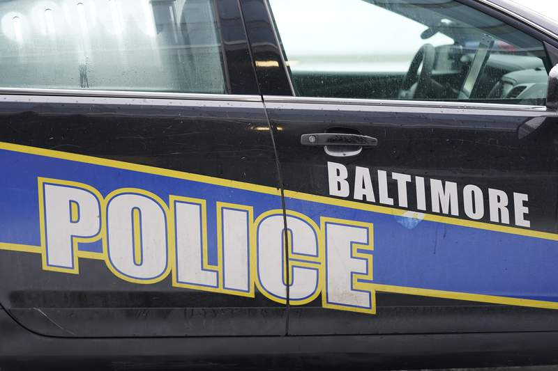 A Baltimore police cruiser is seen outside of a building as officers check on a call, Thursday, Feb. 18, 2021, in Baltimore. New Maryland laws to increase accountability for investigations into police-involved deaths and create transparency for complaints against officers take effect this week. The laws are part of a package of police reform measures state lawmakers approved this year. One law taking effect Friday, Oct. 1, 2021 creates a unit in the attorney generals office to investigate police-involved deaths. (AP Photo/Julio Cortez)