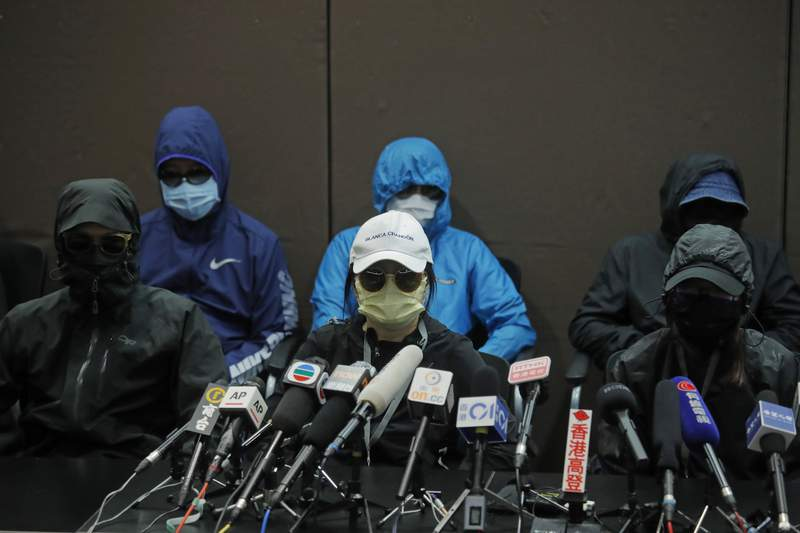 Relatives of 12 Hong Kong activists detained at sea by Chinese authorities attend a press conference in Hong Kong, Saturday, Sept. 12, 2020. They called for their family members to be returned to the territory, saying their legal rights were being violated. (AP Photo/Kin Cheung)