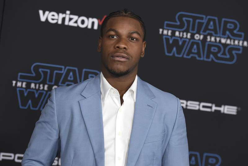"""FILE - In this  Monday, Dec. 16, 2019 file photo, John Boyega arrives at the world premiere of """"Star Wars: The Rise of Skywalker"""" in Los Angeles. British perfume brand Jo Malone has apologized to Black actor John Boyega of Star Wars fame after cutting him out of the Chinese version of a cologne commercial he helped create.  (Jordan Strauss/Invision/AP, File)"""