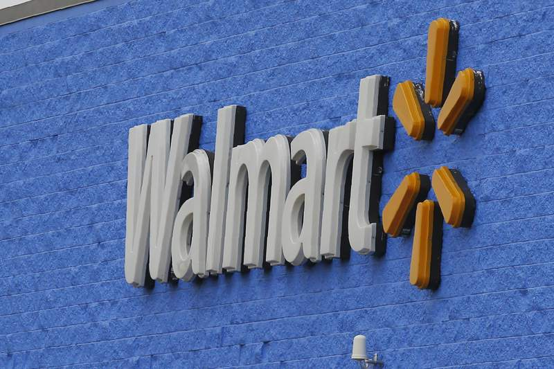 FILE - In this Tuesday, Aug. 4, 2020, file photo, signage is pictured at a Walmart store in Oklahoma City. On Thursday, Oct. 22, 2020, Walmart filed a lawsuit against the U.S. government in a pre-emptive strike in the battle over its responsibility in the opioid abuse crisis. (AP Photo/Sue Ogrocki, File)