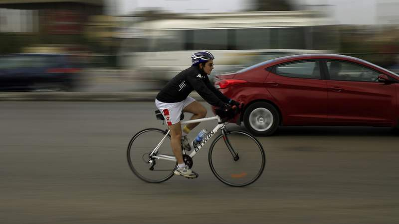 A bicyclist on a road.