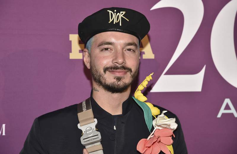 FILE - This Dec. 3, 2019 file photo shows singer J Balvin at the 2019 Footwear News Achievement Awards in New York.  In a pre-taped video that aired Thursday, Aug. 13, 2020,  as Balvin accepted an award at Premios Juventud 2020, the performer revealed he contracted COVID-19 and that it impacted him heavily.(Photo by Evan Agostini/Invision/AP, File)