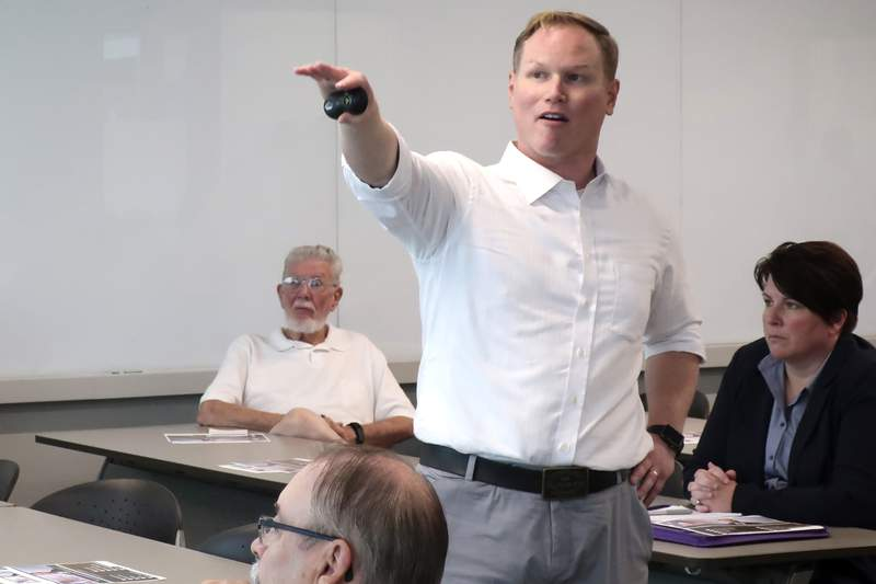 FILE - In this Aug. 26, 2019 file photo, U.S. Rep. Steve Watkins, R-Kan., makes a point during a town hall meeting in Topeka, Kan. Freshman Rep. Watkins is fighting to keep his seat in the states Tuesday, Aug. 4, 2020 Republican primary while facing felony criminal charges. Watkins hoped to overcome a challenge from State Treasurer Jake LaTurner in the 2nd District in eastern Kansas. (AP Photo/John Hanna File)