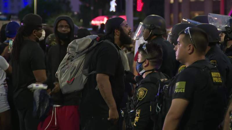 A Black Lives Matter protester yells at an officer in downtown Houston on May 29, 2020.
