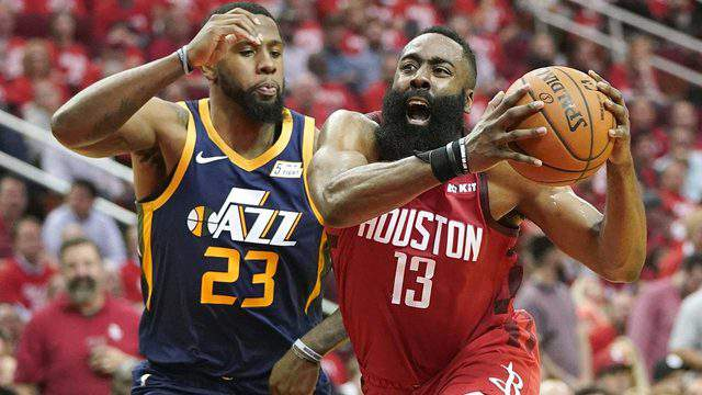 Houston Rockets guard James Harden drives against Utah Jazz forward Royce O'Neale during the first half of Game 2 of a first-round NBA basketball playoff series in Houston, Wednesday, April 17, 2019.